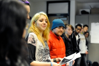 """Laura leads the class in an activity to demonstrate some of the facts we know about Teen Dating Violence. (""""Power of 10"""" Activity in our Curriculum.)"""